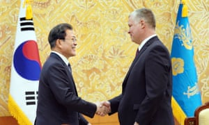 South Korean President Moon Jae-in shakes hands with US Special Representative for North Korea Stephen Biegun