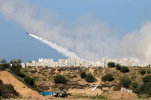 A rocket is launched by Palestinian militant groups into the Mediterranean Sea off the Gaza Strip at the start of their first-ever joint exercise.