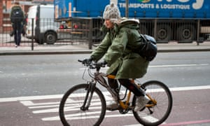 Woman cycling on Euston Road