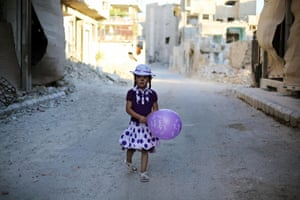 Damascus, Syria: A girl takes part in an activity organised by a charity group