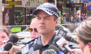 Commander Stuart Bateson has been suspended from the Victorian police force and charged with leaking restricted information.