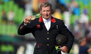 Great Britain's Nick Skelton shows off his gold medal.