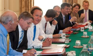 Heywood sits next to Cameron at a cabinet meeting in 2012.