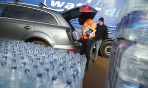 Thames Water workers help distribute bottled water in north London