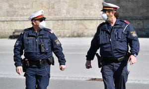 Austrian police officers patrol the deserted streets of Salzburg.
