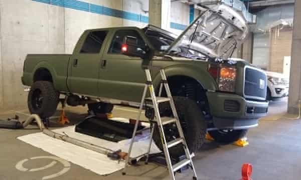 """A diesel truck purchased from the companies featured on the """"Diesel Brothers"""" show on the Discovery Channel. A lab test in Colorado revealed that the modified truck emitted 30 to 40 times the limit for various pollutants. A straight pipe can be seen in the foreground."""