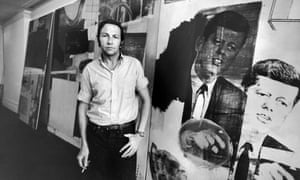 Robert Rauschenberg in his studio, with prints of John F Kennedy.