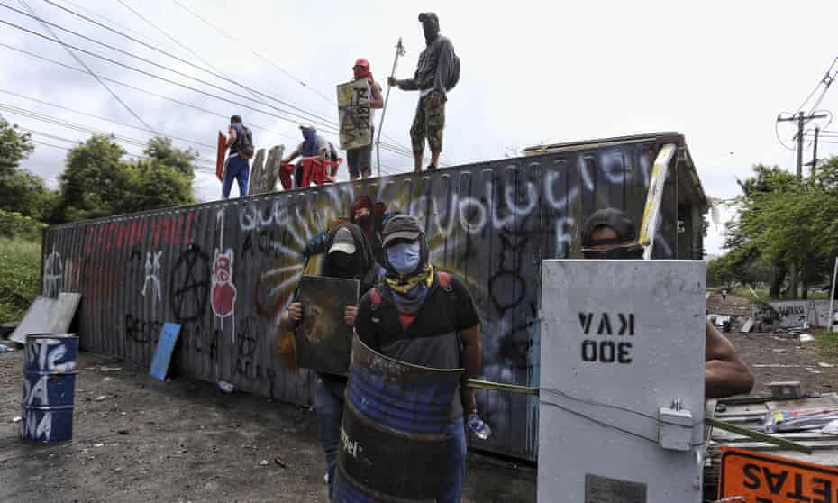 Anti-government protesters man a roadblock they set up after a night of clashes with the police in Yumbo, near Cali, on Tuesday.