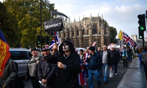 Activists protest outside the Houses of Parliament