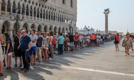 Tourists queue in Venice