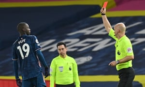 Nicolas Pépé is shown a red card by Anthony Taylor in the second half.