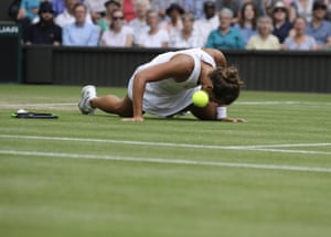 Barbora Strycova of the Czech Republic falls after trying to reach the ball during the women's quarter-final match at Wimbledon against Britain's Johanna Konta.