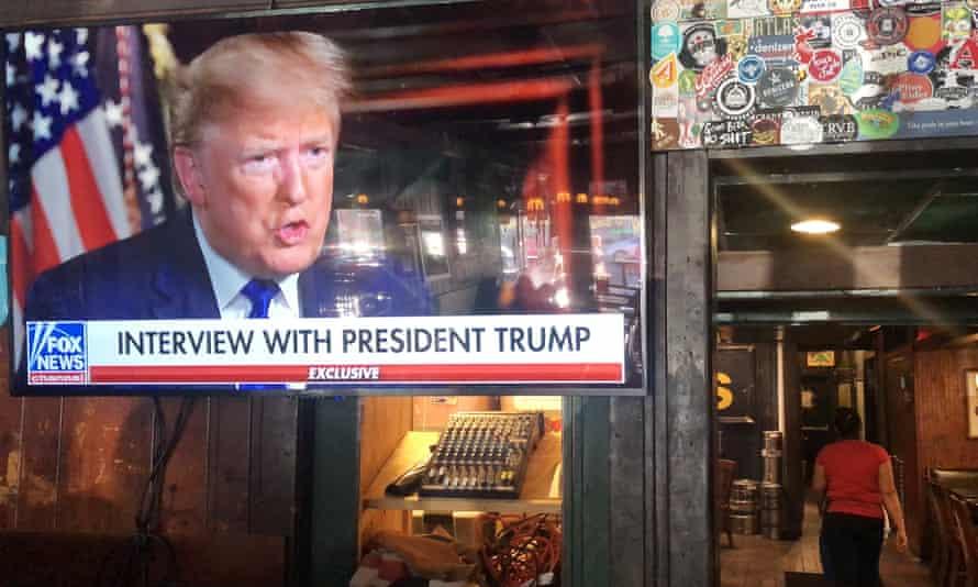 A TV screen showing Donald Trump on Fox News in a bar in Washington DC, 2 February 2020.