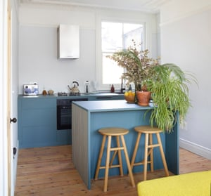 Modern Victorian: the renovated kitchen with custom-built cabinets and abundant plants.