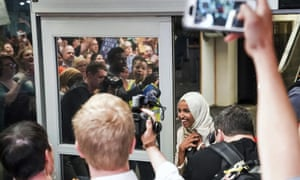 Ilhan Omar receives the cheers of the crowd as she arrives back home in Minneapolis on Thursday.