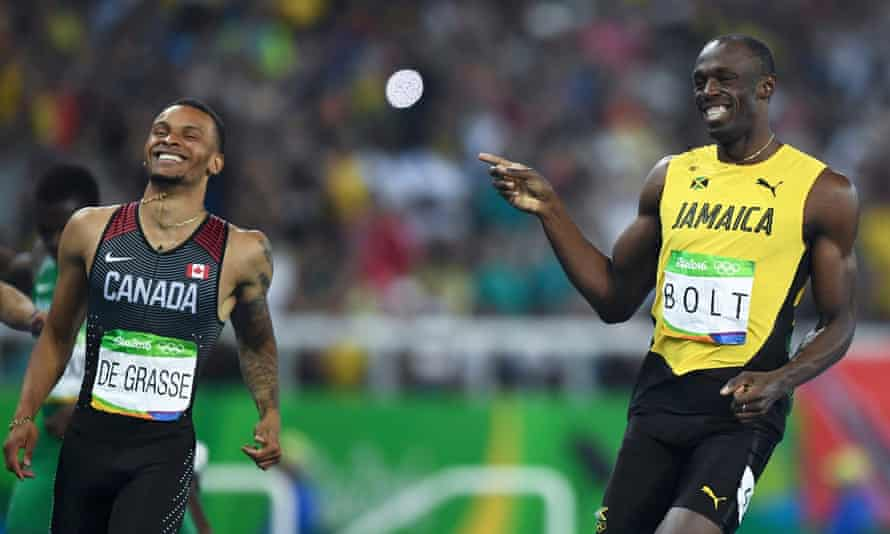 Catching up fast? Bolt with Canada's Andre De Grasse.