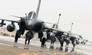 French fighter jets get ready to take off.