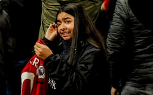A young fan cries after receiving the shirt of Marcus Rashford after the striker's match-winning role in the Manchester Derby.