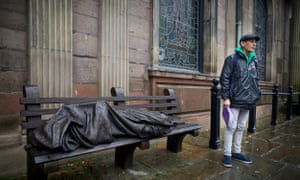 Danny Collins pictured at St Ann's church with a bronze sculpture of Christ as a homeless person.