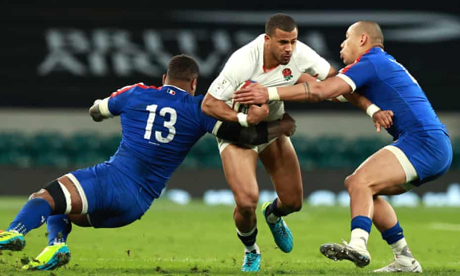 Anthony Watson is tackled by Virimi Vakatawa (left) and Gaël Fickou.