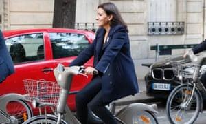 Paris Mayor Anne Hidalgo rides a Velib bicycle in Paris