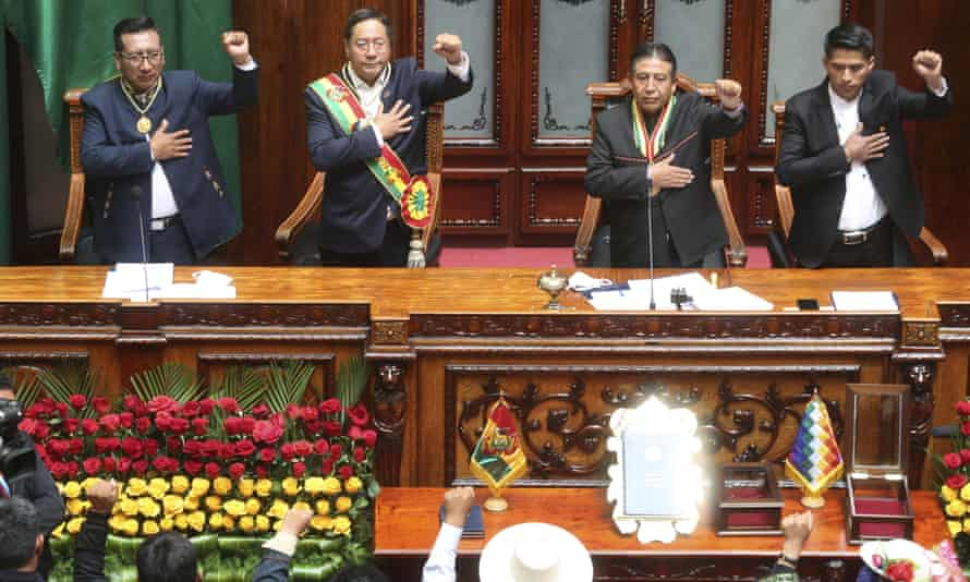 Luis Arce, centre left, and Vice-President David Choquehuanca, centre right, sing the national anthem on their inauguration day at Congress in La Paz.