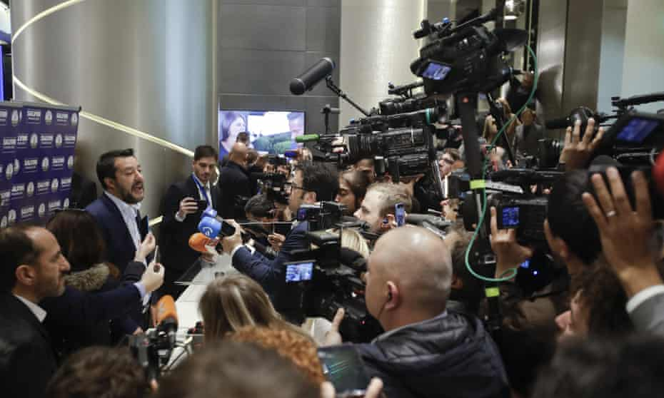 Matteo Salvini talks to journalists at the end of a press conference in Milan.