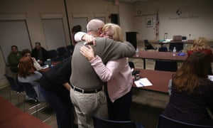 Parents of heroin and opioid addicts embrace during a family addiction support group on 23 March 2016 in Groton, Connecticut.
