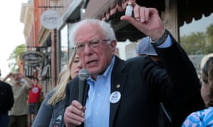 Senator Bernie Sanders holds up a vial of insulin as he talks about the high cost of health care in the US during a rally outside a Canadian pharmacy in Windsor, Ontario.