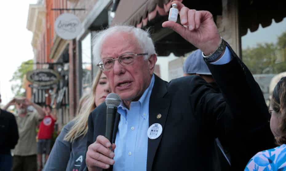 Bernie Sanders holds up a vial of insulin during a rally outside a pharmacy in Windsor, Ontario.