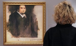 A woman views Portrait of Edmond de Belamy. The artwork was created using an algorithm designed by the French collective Obvious.