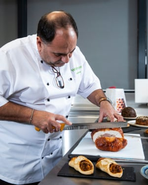Jonathan Moore slices meat in the development kitchen