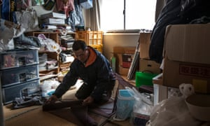 Fisherman Kichiro Sato in the temporary home he shares with son Kazuo, who left the sea after the tsunami to help lead their community's recovery.