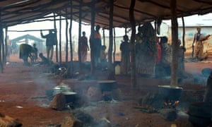 Burundian refugees prepare lunch in a shelter used for cooking at the Nyarugusu refugee camp in north-west Tanzania