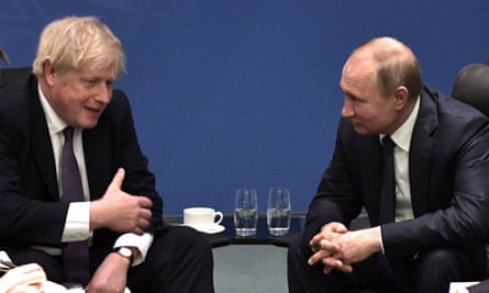 Boris Johnson and Russian President Vladimir Putin during the International Libya Conference in Berlin, Germany