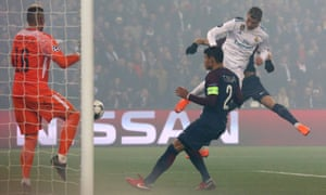 Cristiano Ronaldo heads Real Madrid's opening goal of the night at PSG as the holders cruised through to the Champions League quarter-finals.