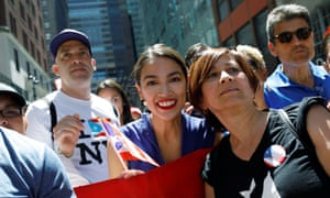 Alexandria Ocasio-Cortez at the Puerto Rican Day parade in New York on Sunday. Ocasio-Cortez is an avowed Democratic socialist.