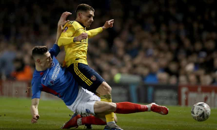 Lucas Torreira is tackled by James Bolton of Portsmouth, a challenge which forced him off 16 minutes into Arsenal's FA Cup win.