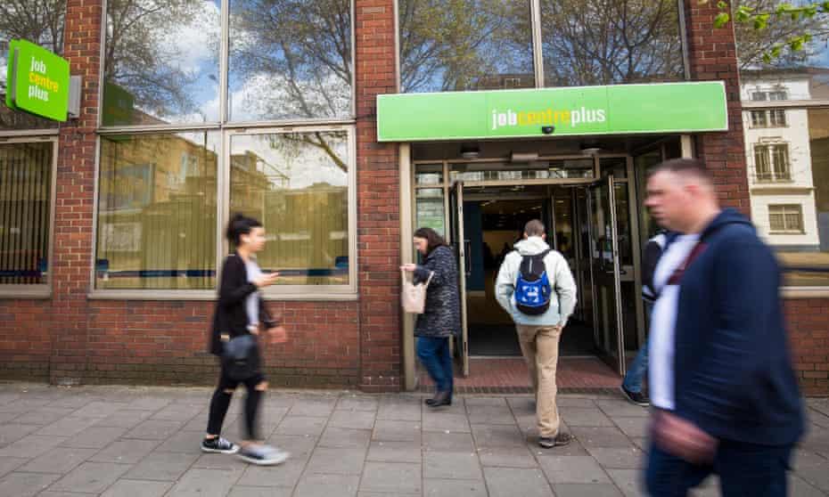 People walk near a jobcentre in London