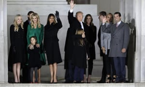 President-elect Donald Trump and his wife Melania Trump stand with family.