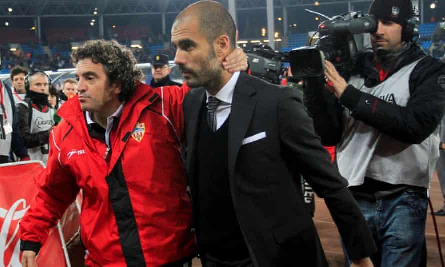 Pep Guardiola in his Barcelona days with Almeria's coach Juanma Lillo