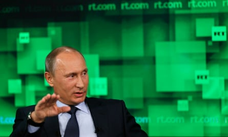 Russian Putin visits the new studios of TV channel Russia Today in 2013.