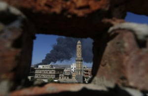 Smokes rise from a Houthi-controlled army camp following an airstrike carried out by the Saudi-led alliance. A five-day humanitarian truce agreed by the Houthi rebels who control the Yemeni capital is due to start later today