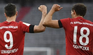 Bayern Munich's Leon Goretzka (right) celebrates scoring their first goal with Robert Lewandowski.