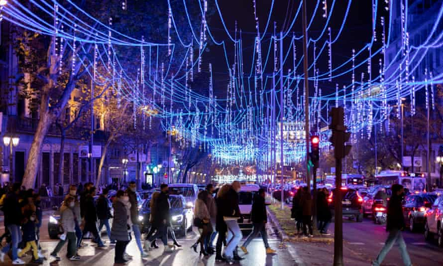 The protest came a week after Madrid switched on its extravagant Christmas lights, pictured.