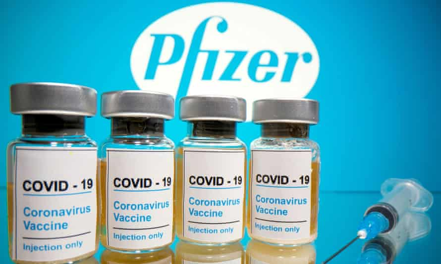 Vials with a sticker reading 'Covid-19 / Coronavirus vaccine / Injection only' in front of a Pfizer logo
