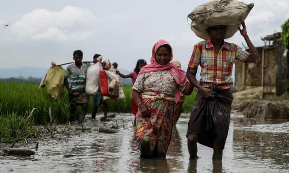 Rohingya people fleeing from Myanmar military operations in Rakhine state cross the Bangladesh border at Cox's Bazar.