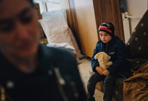Six-year-old Gor waits inside a distribution centre in the city of Goris