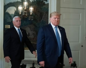 Donald Trump arrives with Vice President Mike Pence to make a statement at the White House.