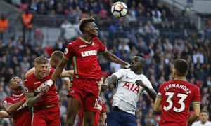 Swansea City's Tammy Abraham heads the ball clear.
